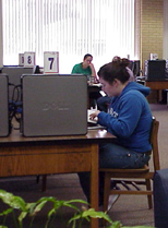 A student studying next to a computer on the first floor